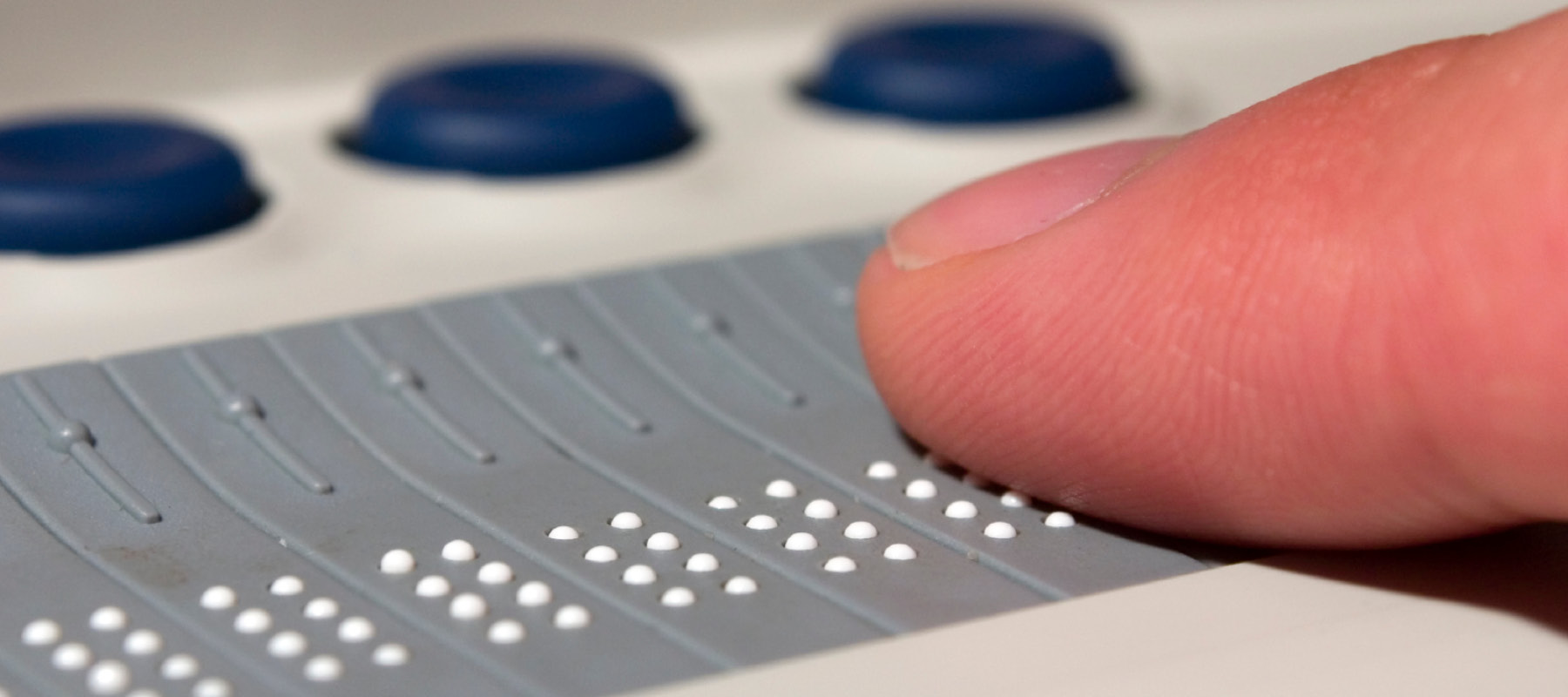 Finger on braille tool