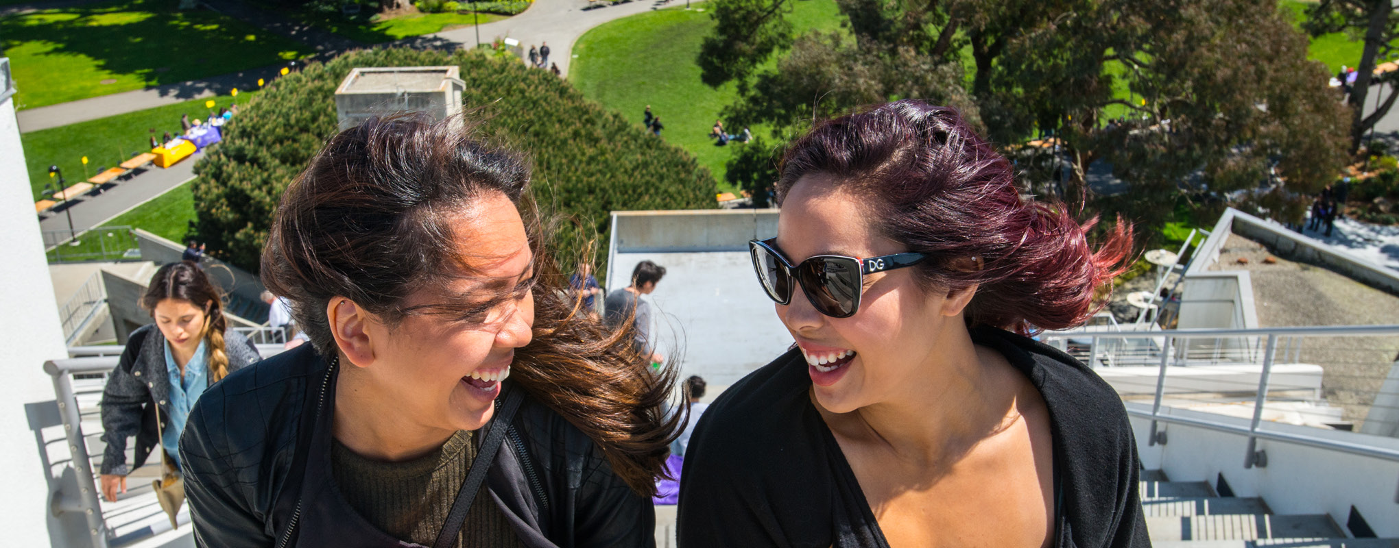 Two female students walking to the roof of Ceasar Chavez Student Center
